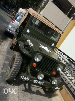 An antique Willys Jeep of  with clear