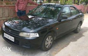 Mitsubishi Lancer lpg  Kms