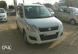 First Owner, Green CNG WagonR Lxi  DL number