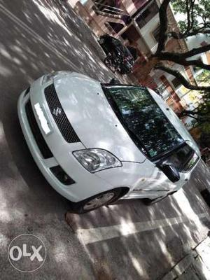 Swift Vxi Pearl White color Petrol car Bangalore