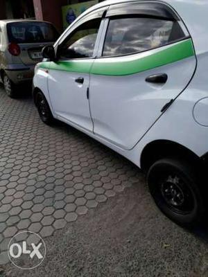 Green local taxi Eon petrol  Kms  year